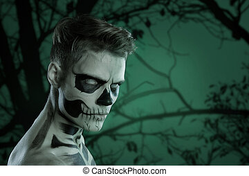 Dia de los Muerto Costume - Day of the dead is a mexican holiday. Here is a man with skull face. Halloween