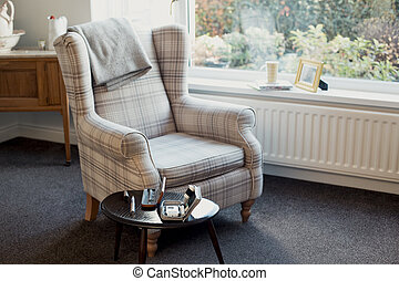 Diabetes at Home - Empty living room with an armchair and a ...