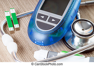 Diabetes - Blood glucose meter and stethoscope
