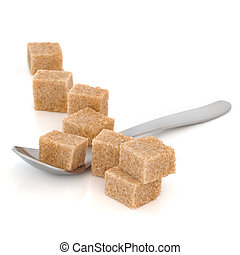 Diabetes Danger - Brown sugar cubes in a spoon and scattered...