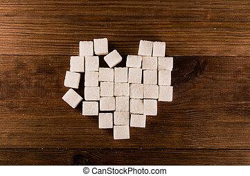 Diabetes is terrible disease. Heart of sugar cubes