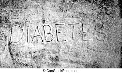 Diabetes written into sugar powder being blow away in slow...