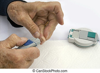 Diabetic Testing Sugar Levels - Closeup hands of a senior...