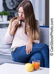 Diabetic woman controlling glucose level