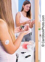 Diabetic woman taking diabetes medication
