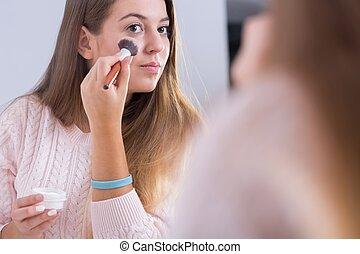 Diabetic woman using dermatological cosmetics