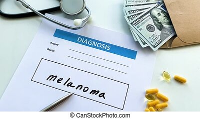 Diagnosis melanoma in a medical form on the doctor desk