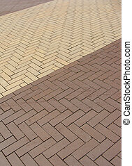 diagonal layed yellow pavement tiles in 2 colors