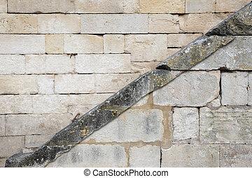 Diagonal line on a stone wall