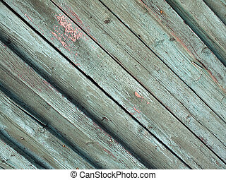 Diagonal view of the old fence from wooden planks
