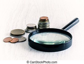 diagram of coins and magnifying glass