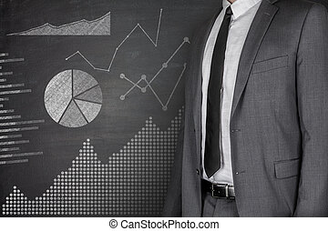 Diagrams and Businessman on Blackboard
