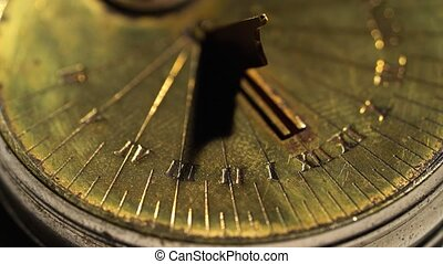 Dial of a sundial on a white background. Close up - Dial of...