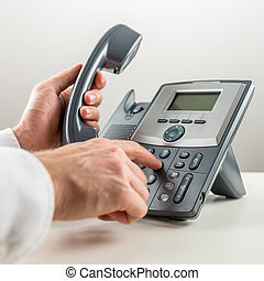Dialaing a telephone number. - Closeup of male hand dialing...