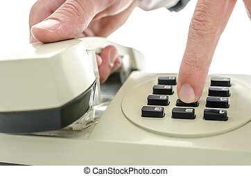 Dialing a number on an old telephone