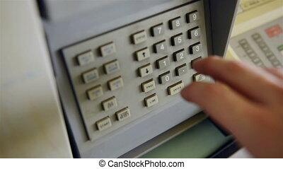 Dialing a sequence into a security panel closeup