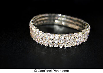 Photo of a bracelet with diamonds.