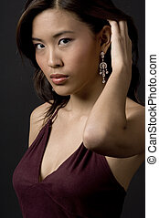 Diamond Earring - A beautiful asian woman shows off a ...