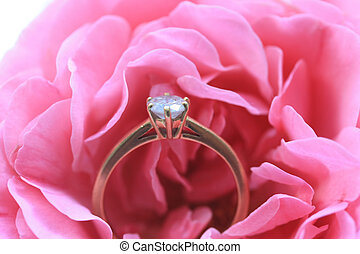 Diamond engagement ring in a pink rose