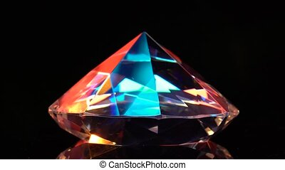 Diamond glows with highlights because it is multifaceted and...