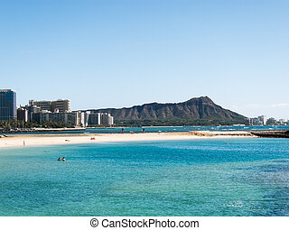 Diamond Head from Waikiki with blue water in the foreground