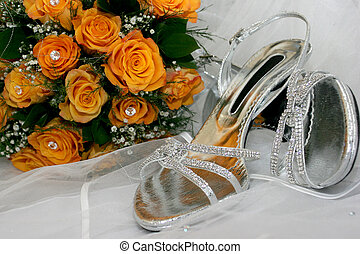 Two silver diamond high heal shoes