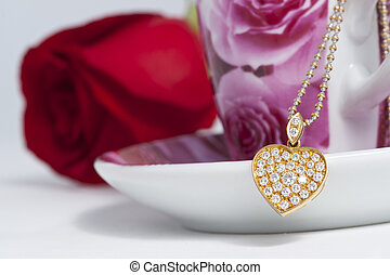 Diamond heart shape pendant and red rose