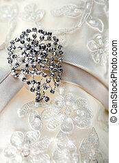Diamond jewelry on vintage wedding dress - Silver brooch on...