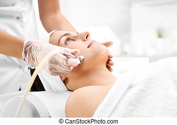 Diamond microdermabrasion - woman during a microdermabrasion...
