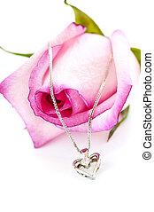 Diamond necklace on rose