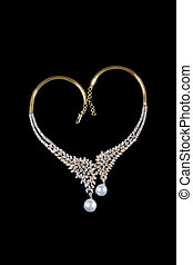 Diamond necklace with pearl pendent over black background