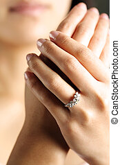A woman hand wearing a diamond ring
