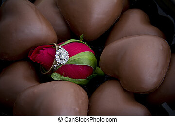 Diamond Ring around a Rose Bud Surrounded by Heart Chocolates