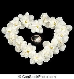 Diamond Ring in Heart Made of White Jasmine Flowers on Black Background