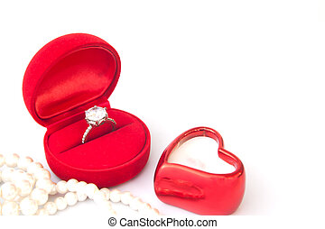 Diamond ring in red box on white background, Wedding or Engagement