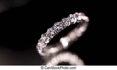 Diamond ring on black background - Engagement diamond ring...