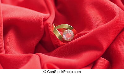 Diamond ring on red satin