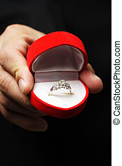 Diamond ring - A man showing a diamond ring, can be used as...