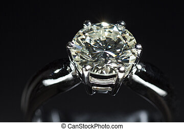 Two carat diamond ring with a dark background