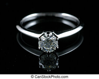 Diamond ring with reflection in isolated black background