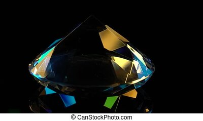 Diamond slowly rotates with a sharp end up. Black background...