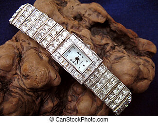 Close up of ladies diamond watch on wood burl