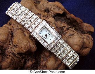 Diamond watch on burl - Close up of ladies diamond watch on...