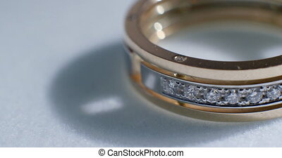 Diamond wedding golden ring macro shot. Transfusion of light...