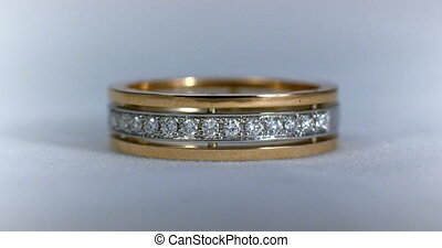 Diamond wedding golden ring macro shot. Transfusion of light...