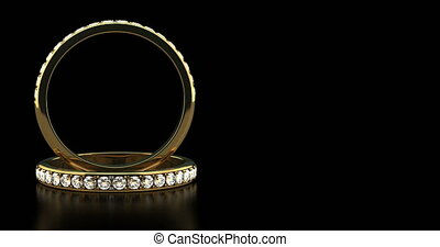 Diamond Wedding Rings on Black Background