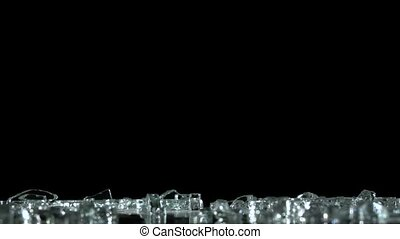 Diamonds and crystals fall and hit the floor. Black...