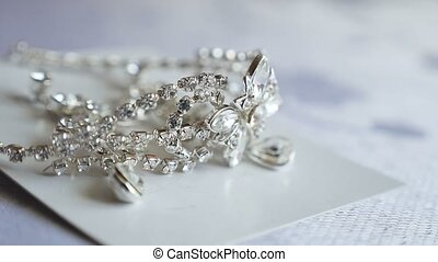 diamonds decoration lies on the table earrings. wedding...