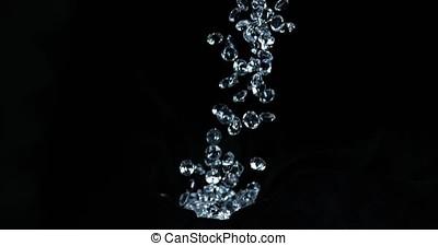 Diamonds falling against Black Background, Slow motion 4K