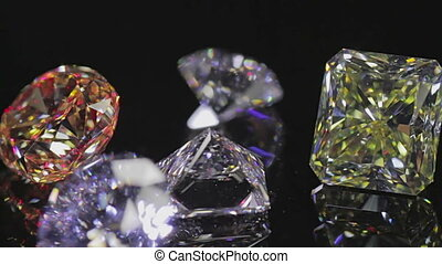 Diamonds on black - Group of large white and yellow diamond...